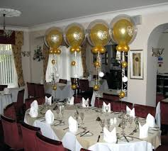 50th wedding anniversary decorating ideas balloon wedding anniversary decorations with round table and red fabric chairs