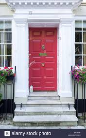 uk front door to house with stone stepilk bottle on step stock photo royalty free image