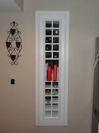 Furniture Charming Wine Rack Design With White Stained Wood Wall Interior  Vertical Bookshelves Black Stainless Steel