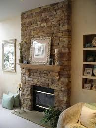 interior masonic stone veneer fireplace featuring mantel shelf stacked stone fireplace veneer