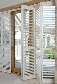 exterior wood door treatment. tracked full height window shutters are perfect for your patio doors. exterior wood door treatment
