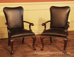 queen anne leather arm chairs with camel back and brass nail trim