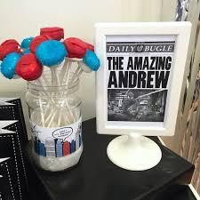 marshmallow pops newspaper sign from a spiderman birthday party via kara s party ideas karaspartyideas
