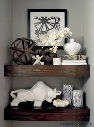 since this post i ve painted our powder room and updated the shelf styling here s what they look like today
