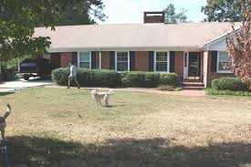 painted brick houses before and with painted brick house before and