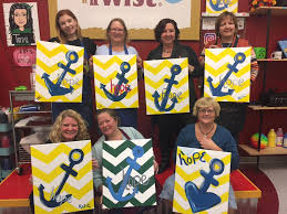 las enjoying at night out together at painting with a twist