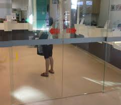 stickers on frameless glass door for signage