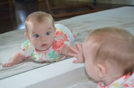 toddler looking in mirror. when toddler looking in mirror c