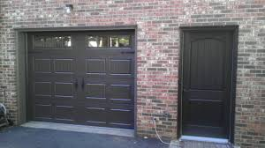 grey garage door design with brick walls