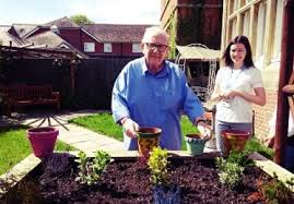 Gardening at Woodbury House Care Home   brighterkind