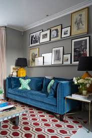 office picture frames living room transitional with blue sofa yellow table lamp rug pattern