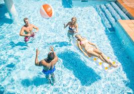 swimming pool with friends. Modren Swimming Group Of Friends Playing And Relaxing In A Swimming Pool During Summer  Holidays Stock Photo  Intended Swimming Pool With Friends I
