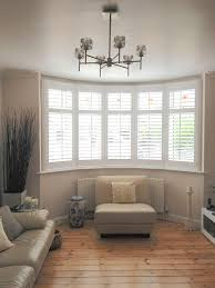 bay window furniture living. some amazing shutters in a bay window furniture living