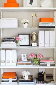 office bookshelf design. bookcase styling love the pop of orange with pink flowers bookcases by kapito muller interiors for design darling office bookshelf