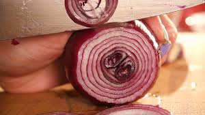 cutting board with food. Chef Slices The Onion. Knife, Cutting Board, Quick Of Vegetables Board With Food E
