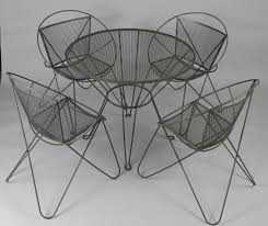 a very nice vintage 1960s wrought iron garden dining set by woodard with four chairs
