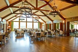 large dining restaurant space designed with round dining tab table set under decorative wooden gables also