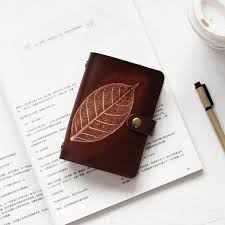 custom gift exchange gifts birthday gifts such as the first layer of vegetable tanned cowhide leaves embossed dark brown a7 loose leaf notebook manual