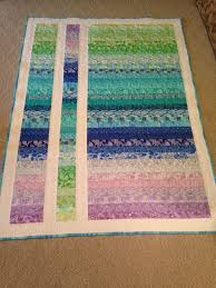 Best 25+ Strip quilts ideas on Pinterest | Strip quilt patterns ... & Easy jelly roll quilt - strips sewn, then cut and the center one upside  down. Adamdwight.com