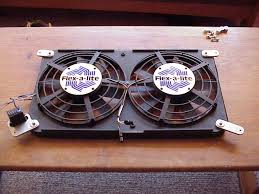 fan kit. the fan fits radiator perfectly. there are custom aluminum brackets that mount it to stock mounting points of shroud. kit
