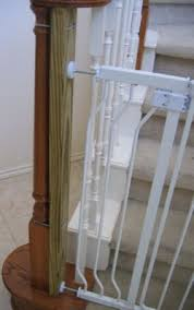 To mount baby gate to irregularly shaped banister post: attach 2x4 ...