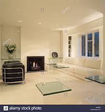 Living Room With Leather Sofa Large White Leather Sofa Below Window In Modern All White Living