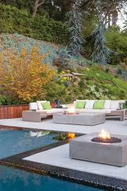 inspiration for a contemporary backyard patio in new york with a fire feature concrete slab