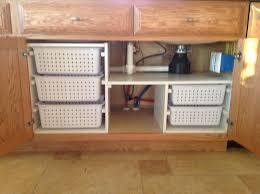 under kitchen sink organization my husband built