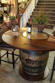 17 best ideas about whiskey barrel furniture on whisky barrel table beautifully handcrafted stonebarnfurnishings