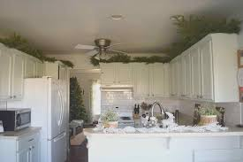 cabinets with baskets. decorating above kitchen cabinets with baskets