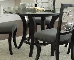 black round glass dining table