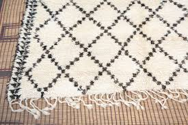 tribal moroccan white and black beni ouarain rug for