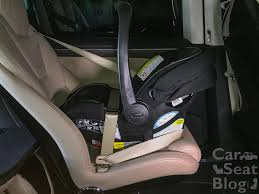 pictures where the carrier is installed euro style without the base the shoulder belt rests down low against the vehicle seat with some slack in it