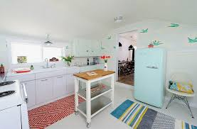 view in gallery vintage and retro design elements enliven this small kitchen with a rolling island