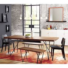 super simple slightly modern and very chic the wood on this table ages beautifully and it s perfect for doubling as a desk to do work due to its sy