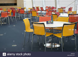 office canteen. Chairs And Tables Arranged In Office Canteen