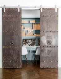 rustic and antique sliding doors add uniqueness to the small home office from robert