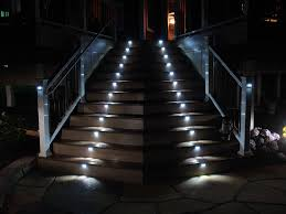 staircase lighting design. Decorations:Amazing Modern Lighting Staircase With Led Design Inspiration And Brown Plain Laminated Tiles