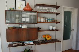 furniture brown wooden floating wall shelves with five racks on white wall connected by glass