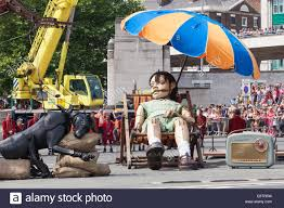 metre giant umbrella: little girl giant and xolo the puppet dog sleeping outside queensway tunnel
