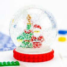 lego santa and tree inside of a diy snow globe