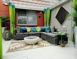Coral Outdoor Pillows with oversized outdoor lantern patio
