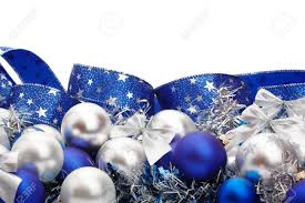 Silver and blue Christmas decorations and tree adornments on white  background with copy space above Stock