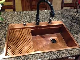 this is a photo of a typical 33x22 retrofit copper sink installation in a granite top this copper sink replaced an outdated double bowl sink
