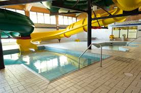 indoor pool and hot tub with a slide. Wonderful Indoor Two Large Waterslides Throughout Indoor Pool And Hot Tub With A Slide O