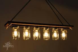 mason jar lighting fixture. Rustic Wood Mason Jar Chandelier Tutorial - The Summery Umbrella Featured  On @Remodelaholic Lighting Fixture
