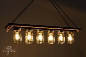 rustic wood mason jar chandelier tutorial the summery umbrella featured on remodelaholic