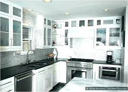 black and white kitchen cabinets with cabinet granite countertops gray walls
