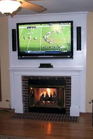 smlf hanging flat screen tv above gas fireplace white mounting hiding wires vent free wall hung ventless