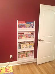 white wooden wall book shelves mixed red color in nursery f room designer office furniture bookcase book shelf library bookshelf read office
